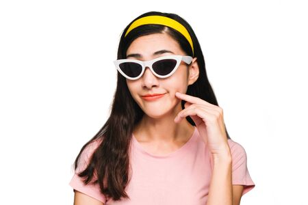 Young beautiful asian woman,long black hair Wearing a pink t-shirt, White fashion glasses, Yellow hair band, glad and smiling,shocked, surprised isolated on white background