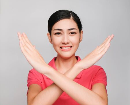young beautiful asian woman wore pink t shirt, Showed Crossed hands and smile Reklamní fotografie