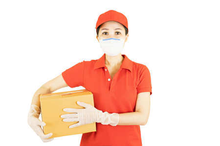 Asian staff holding a box isolated on white background. Courier in protective mask and medical gloves,concept delivers service under quarantine Banque d'images