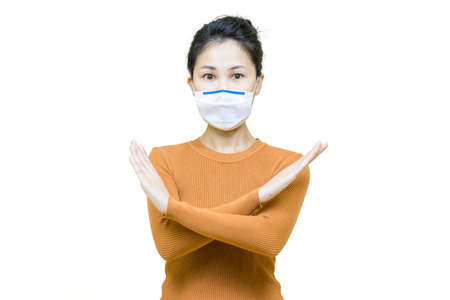 Young asian woman in brown shirt wore medical face mask isolated on white background, health care concept.