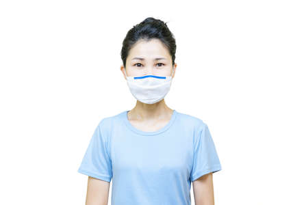 Young asian woman in blue t-shirt wore medical face mask isolated on white background,health care concept. Banco de Imagens
