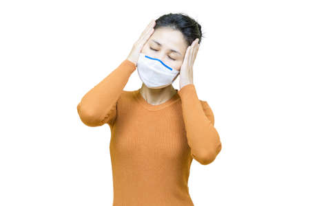 Headache,Young asian woman in brown shirt wore medical face mask isolated on white background,health care concept. Banco de Imagens