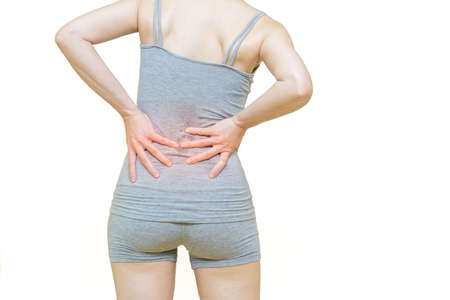 low body of a woman in gray clothes put her hands on the back area at spot of ache and mark  red,waist pain, Health-care concept on white background