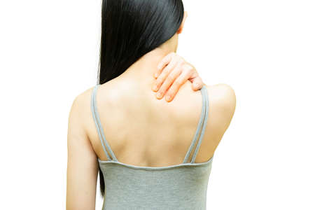 Back of woman in gray undershirt put her hands on the sholder area, nape pain or neck ache, Health-care concept on white background
