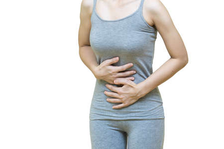 Woman in gray clothes put her hands on the Stomach area at spot of ache, abdominal pain, Health-care concept on white background