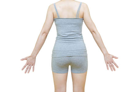 The body of a woman in gray clothes ,rear view.Health-care concept on white background Banco de Imagens