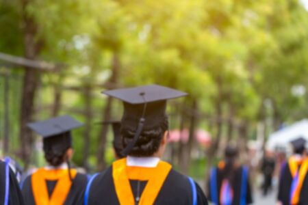 Blurred image back side view a group higher education graduation of graduates during commencement. Congratulation in University concept, Education concept. Stock Photo