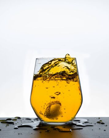 Water splashing from glass. Reklamní fotografie