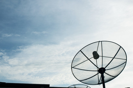 A black satellite dish on twilight sky  photo