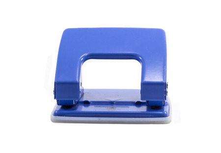 Blue office paper hole puncher isolated on white background photo