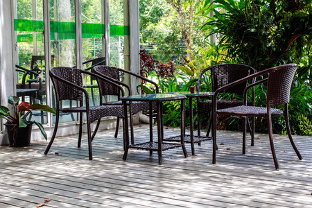 Table and blue chairs in the garden photo