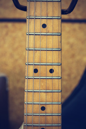 fret: Close up macro of guitar strings vintage style