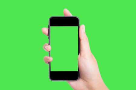 green screen: Photo blank. Women hand holding blank mobile smart phone on green screen.
