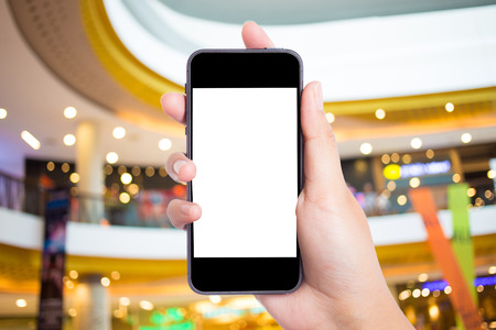 mobile phone: Photo blank. Women hand holding blank mobile smart phone in the shopping mall. Stock Photo