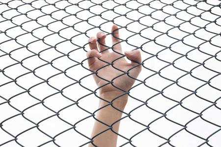 jail: closeup of hand in jail