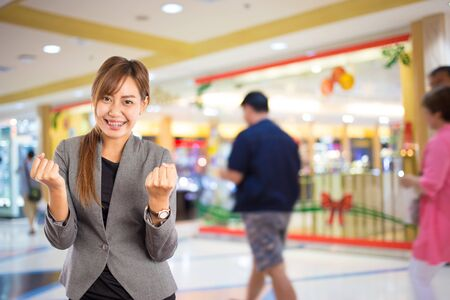 busy person: Businesswoman in the shopping mall.