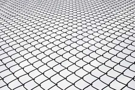 wire fence: Metal wire fence protection on white for background. Stock Photo