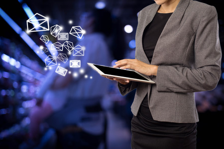 email: Business woman sending email by using digital tablet