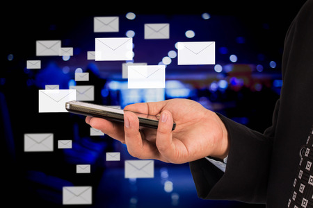 conection: Business man sending email Stock Photo