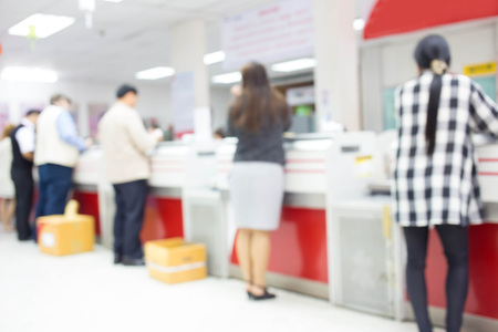 Blur image of post office interior and people - customer service