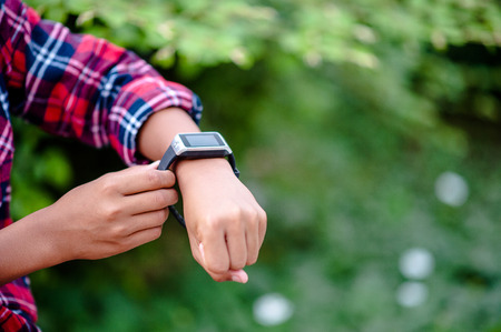Hands and digital watches of boys Watch the time in the wrist. The orientation is punctual. Stock Photo