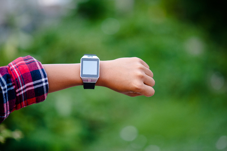 Hands and digital watches of boys Watch the time in the wrist. The orientation is punctual. Stockfoto