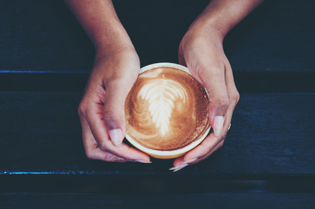 Hands and hot coffee to drink coffee every morning of coffee lovers. Morning coffee is served. Food and Drink Concepts