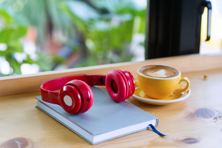 Factories and headphones are placed on wooden boards. Ready to work happily. In the morning of the staff Stock Photo
