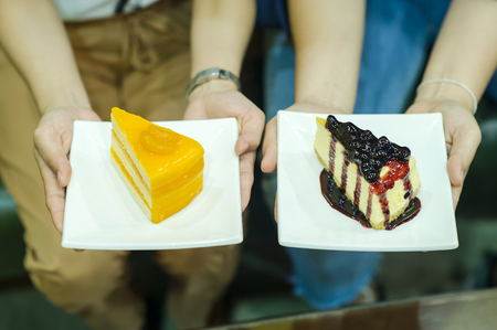 Hand and Cake of the Girl Delicious desserts Snacks of health lover Healthy Diet Concepts Stock Photo