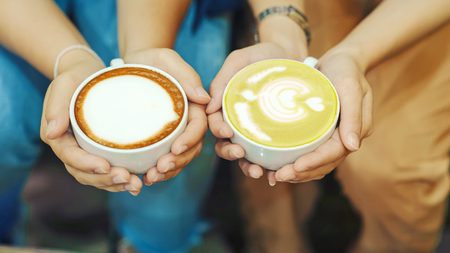 Hand and coffee and hot green tea Young people love to drink hot drinks. Healthy Coffee Food and Drink Concepts