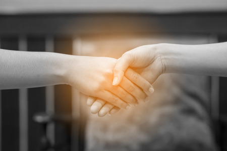 Join the hands of two people. And the greeting of friends. Communicate in team and teamwork. Teamwork concept