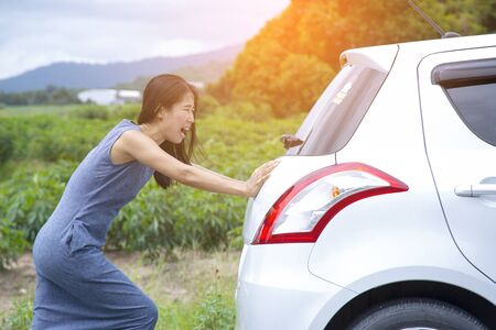 Women are in trouble.The car is brokens. Stock Photo
