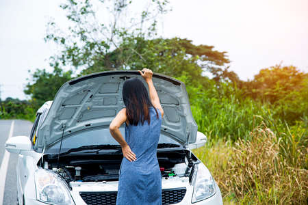 Women are very stressed because of her car breakdown. She did not know what to do.