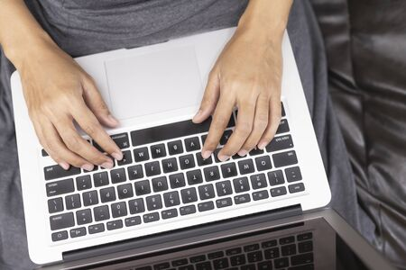 Hand typing on computer keyboard. Business and Technology Concepts.