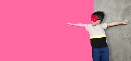 Gender selection, children's fantasies, boys dressed in superhero costumes are reaching out to pink backgrounds, identifying gender or development of young children.