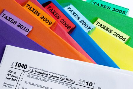 tax return: Colorful folders for income taxes of years 2010 - 2005