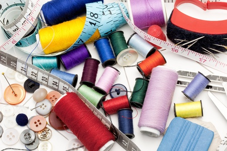 Colorful Threads, Needle, Measuring Tape, Buttons photo