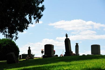 headstones: Cemetery - Old Headstones on Hillside Stock Photo