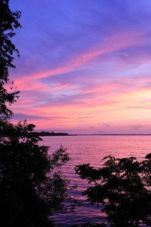 Sunset - Pink & Purple Sky at Sunset Over Lake Petenwell, Strongs Prairie, Wisconsin Stock Photo
