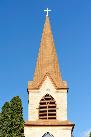 Church Steeple Against Blue Sky Background at Crystal Lake, Wisconsin Stock Photo