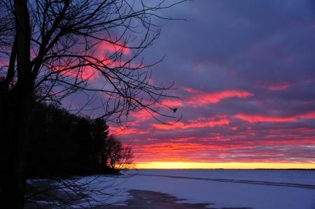 Christmas Day Sunset on Petenwell Lake, Wisconsin - horizontal Stock Photo