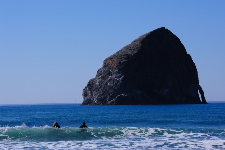 Surfing at Indian Beach, Ecola State Park,  Oregon Stock Photo - 16010368
