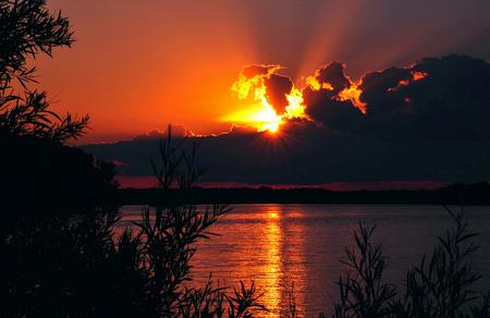 Fall Sunburst over Petenwell Lake, Wisconsin Stock Photo