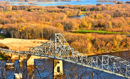 Bridge View over Mississippi River at Lansing, Iowa in Fall Color Stock Photo