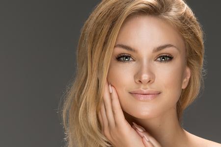 Glamour portrait of beautiful woman model. Summer glow on skin