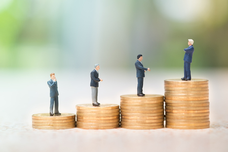Money, Financial, Business Growth concept, Group of businessman miniature figures standing to top of stack of coins to thinking and planning.