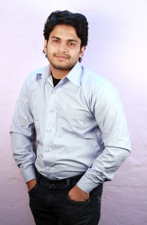 agrassive: young indian male model wearing shirt close up