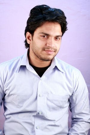 agrassive: yong indian male model wearing shirt close up