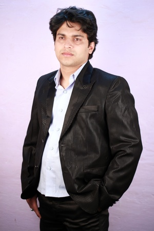 agrassive: yong indian male model wearing formal suit Stock Photo