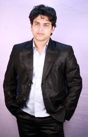 yong indian male model wearing formal suit photo